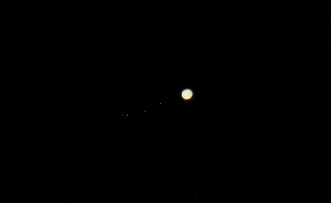 Jupiter, with its for primary satellites, the Gallilean Moons Io, Europa, Ganymede, and Callisto.