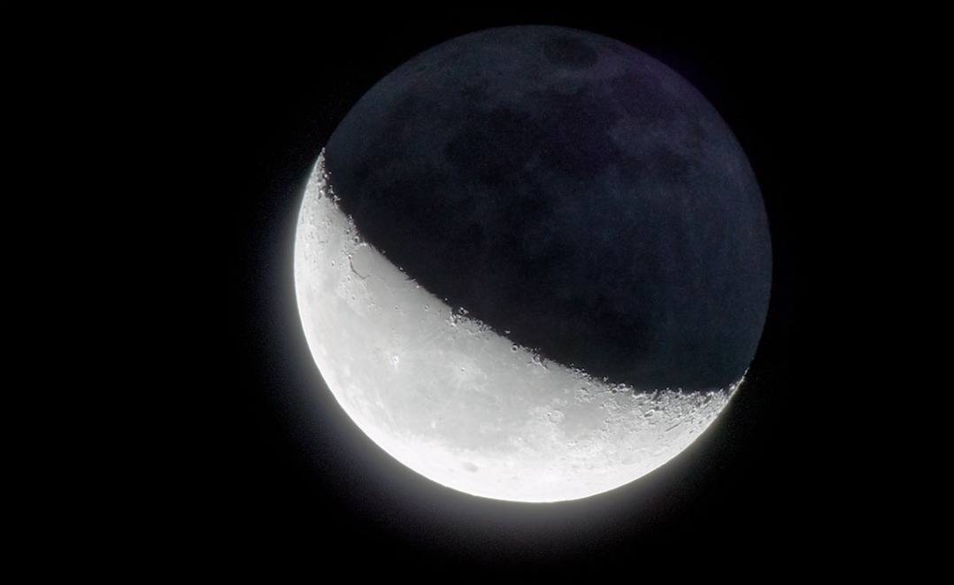 "A ""high dynamic range"" moon, showing both the light and dark parts of the moon simultaneously."